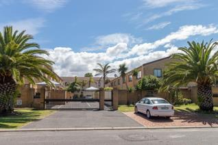 This double storey townhouse is located in a secure complex within short walking ...