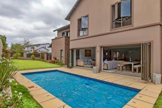 The home offers glorious living areas on the ground floor and a stylish gourmet kitchen ...