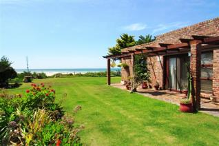 Situated at a prime address RIGHT ON THE BEACH lies this gem of a property, including two completely separate houses on a double stand ...