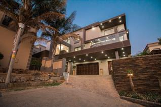 Situated in a peaceful security estate, this modern gem with top-of-the-line features ...