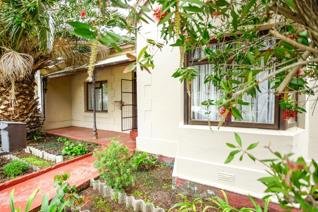 Offering front garden, potential for parking. Three spacious Bedrooms with original ...