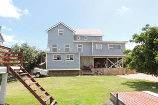 Charming & Friendly. . .  Wonderful wooden home with the best of both worlds, offers ...