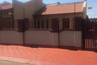 3 Bedrooms with Built-in Cupboards Bathroom Fitted Kitchen Dining room Lounge TV Room Double Garage Electric Fence