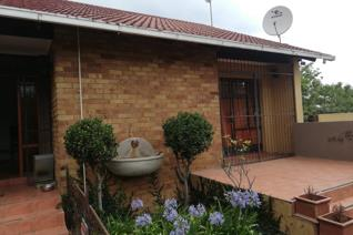 House and flatlet has a pre-paid.  Spacious op plan living area.