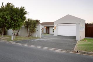 This impressive family home located in an established part of Blouberg Rise and ...