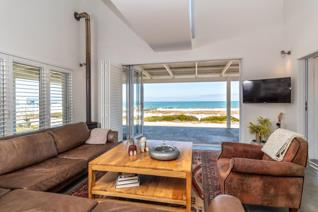 This double storey beach house with a separate, self-contained one bedroom flat, is ...