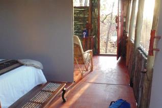 Retire in a rural tribal trust, Venda Village at Pafuri gate overlooking the Mutale ...