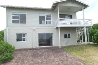 Four bedroom beach house with views. See video above. The open plan living room has a ...