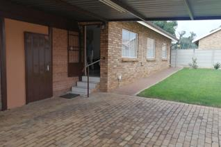 This townhouse offers you the following. Three bedrooms with built-in cupboards, curtain rails and tile flooring. Two bathrooms (MES) ...