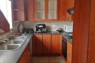 Spacious two bedroom townhouse with build in cupboards.  Bathroom with toilet, basin, shower and bath.  Also separate toilet.  Spacious ...