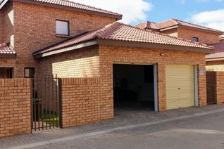 Secure Townhouse offering 3 bedrooms( main with air-con, 2 full bathrooms, open plan and lounge area. Double garages with electric ...