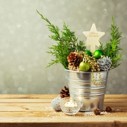 if you prefer a more rustic style of dcor use a combination of natural materials and shiny ornaments to create holiday decorations